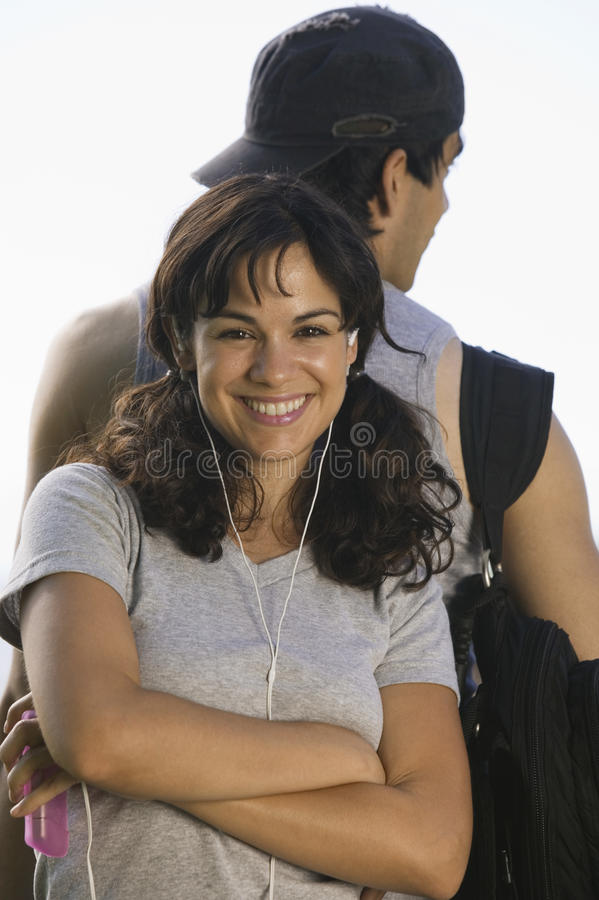 Young couple woman listening to earphones. stock photo