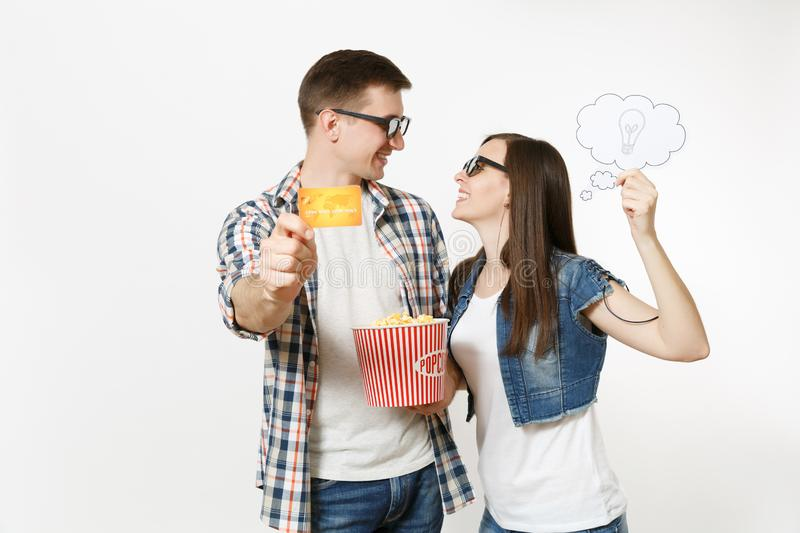 Young couple, woman and man in 3d glasses watching movie film on date holding bucket of popcorn, say cloud with. Young couple, women and men in 3d glasses royalty free stock photography