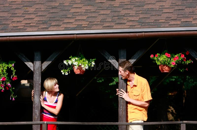 Young couple on wooden terrace royalty free stock photo