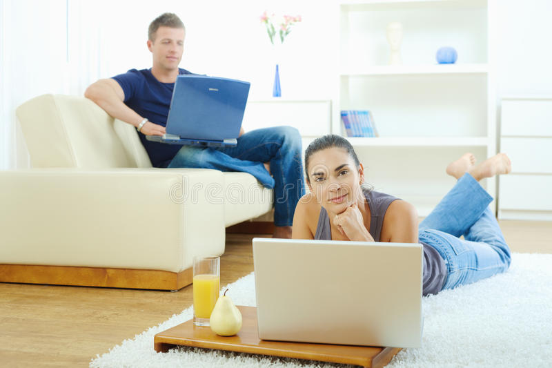 Young couple working at home