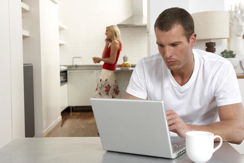 Young couple working from home royalty free stock photography