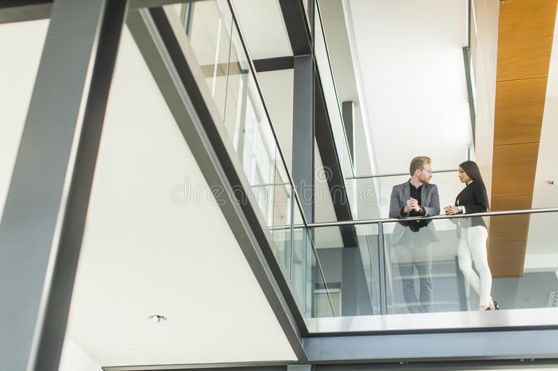Young couple working in the office. Couple working in the office stock image