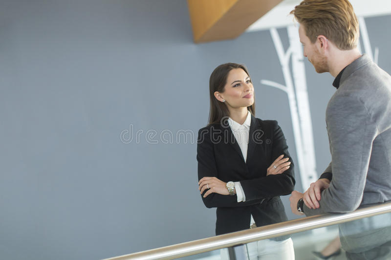 Young couple working in the office. Young couple working together in the office royalty free stock images