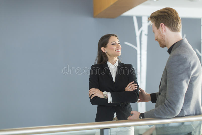 Young couple working in the office. Young couple working together in the office stock image