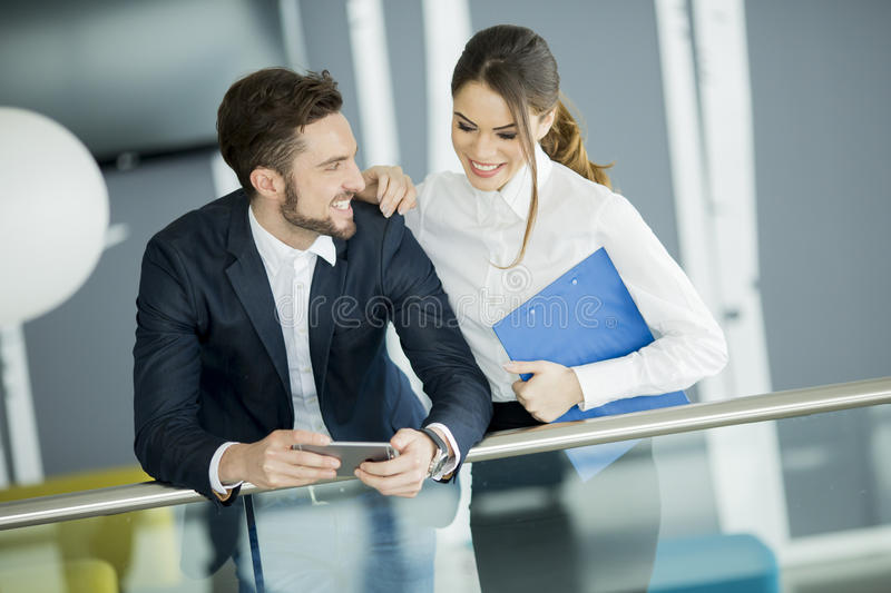 Young couple working in the office. Young couple working together in the office stock photos