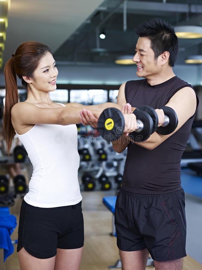 Young couple working out in gym stock image