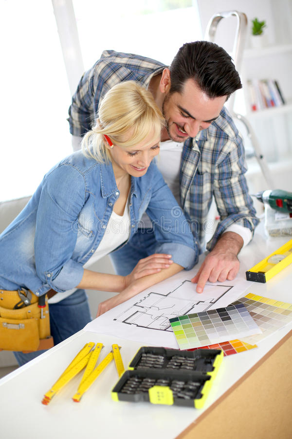 Young couple working together for house stock photos