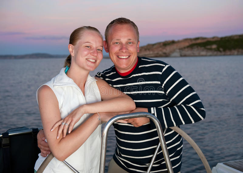 Young couple on yacht stock photo