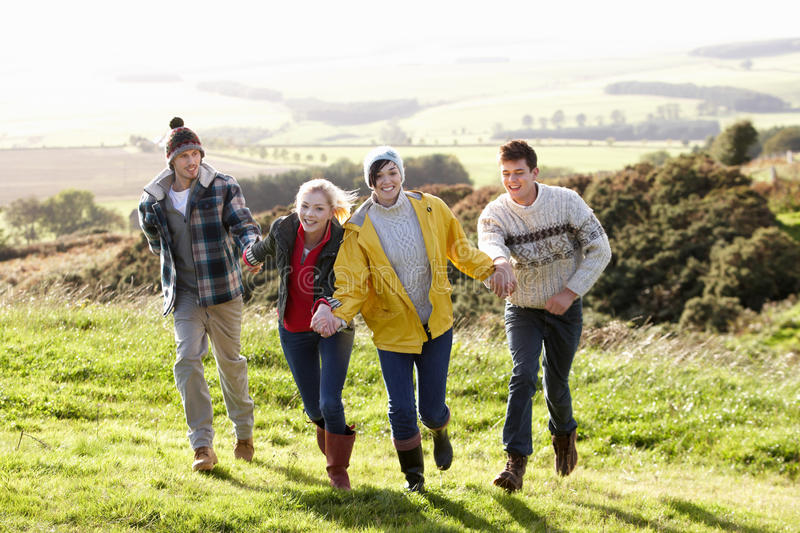 Young couples on country walk. Having fun royalty free stock photo