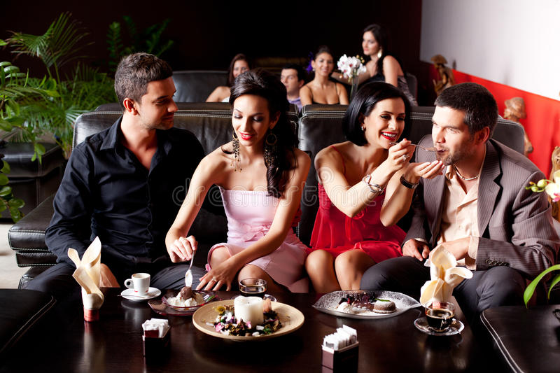 Young couples eating deserts stock image