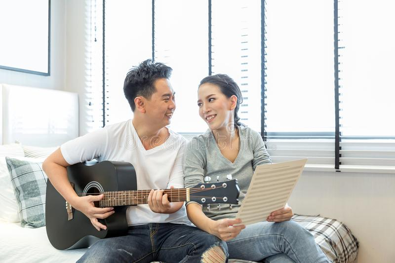Couples playing guitar royalty free stock photos