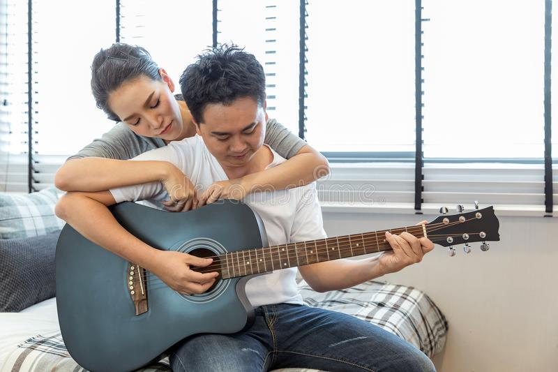 Couples playing guitar royalty free stock images