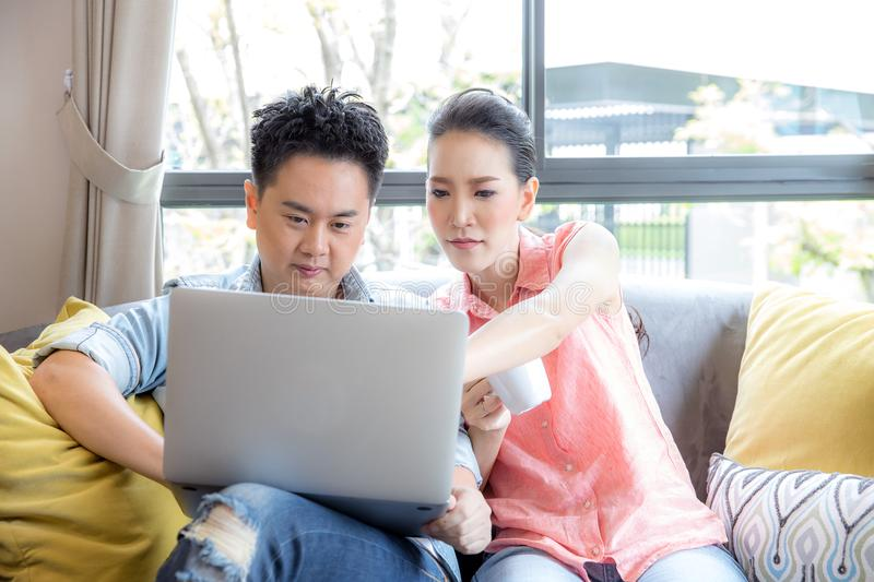 Young Couples using laptop stock images