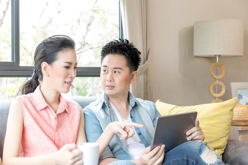 Young Couples using tablet royalty free stock photography