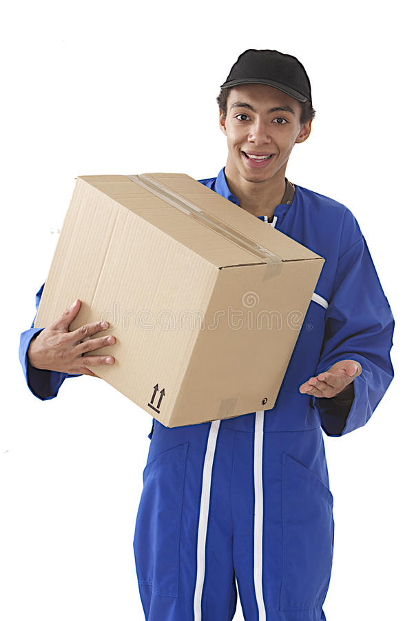 Young courier boy moving boxes stock photo