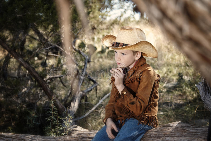 Young cowboy. Wearing a hat royalty free stock photography