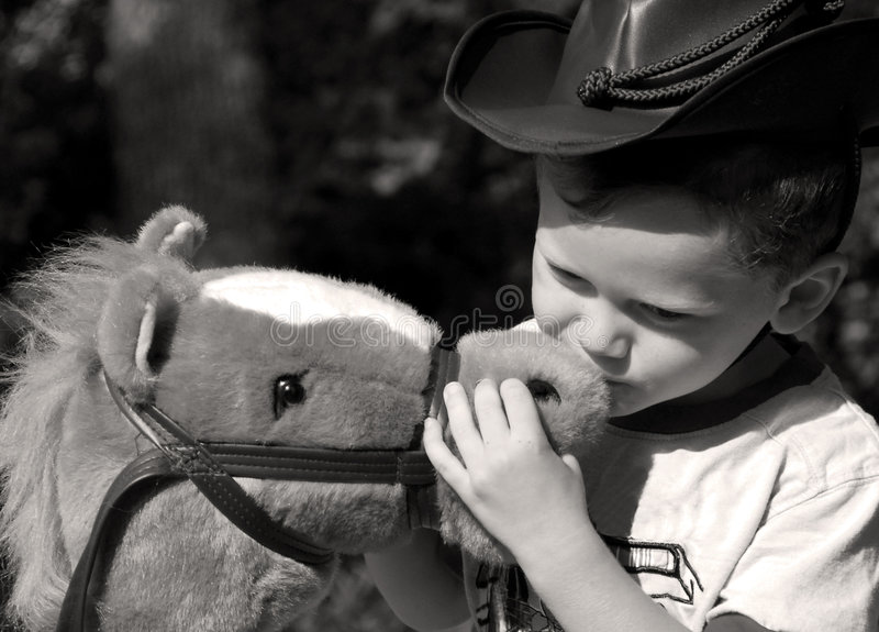 Download Young Cowboy Kissing His Horse Stock Images - Image: 6225694