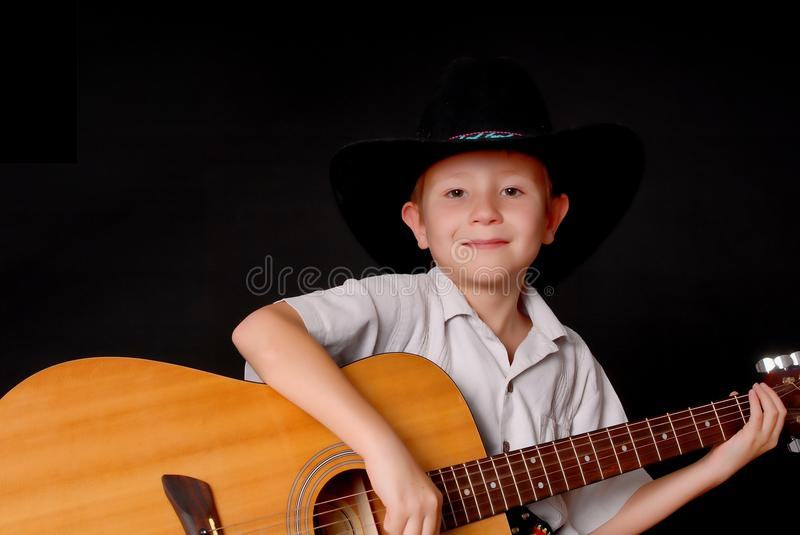 Young Cowboy Musician royalty free stock photography