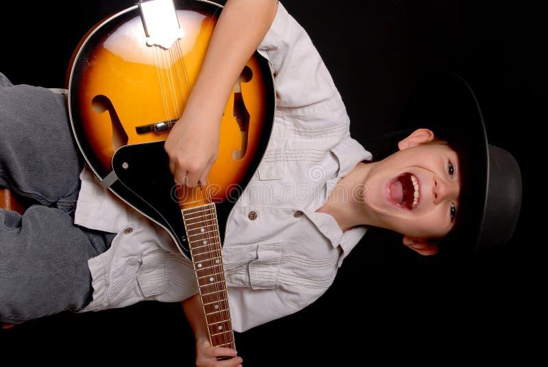 Young Cowboy Musician royalty free stock photos