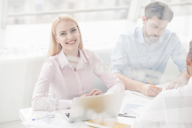 Young coworkers having brainstorming session in modern office royalty free stock image