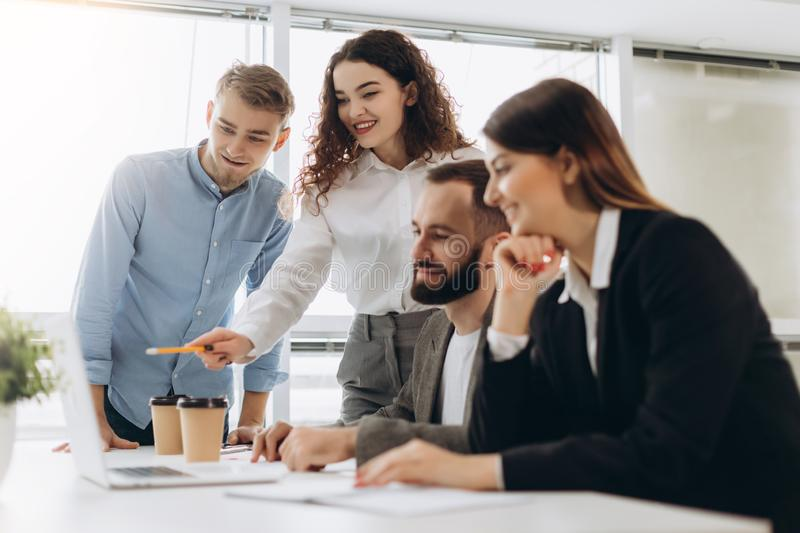 Young coworkers. Young modern colleagues in smart casual wear working while spending time in the office.  royalty free stock photo
