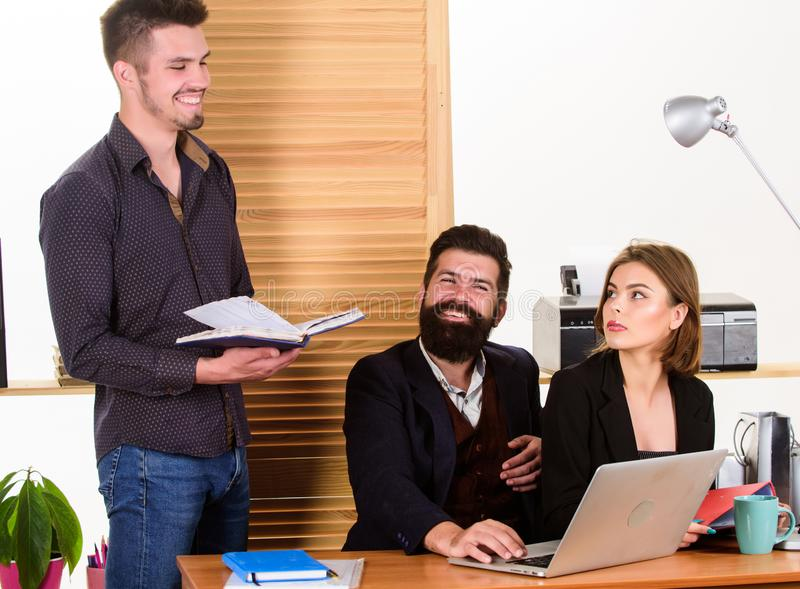 Young coworkers. People making great business discussion in modern coworking office. Business people working and stock image