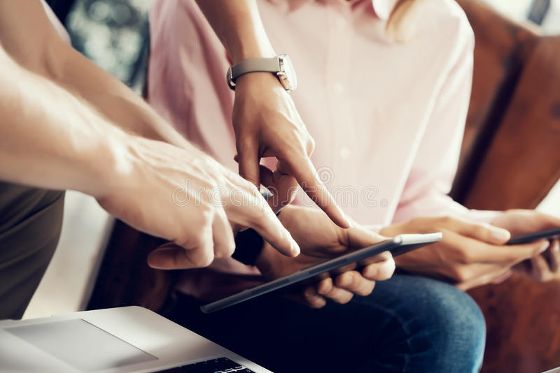 Young Coworkers Team Analyze Meeting Report Electronic Gadgets.Businessmans Startup Online Marketing Project.Creative stock image