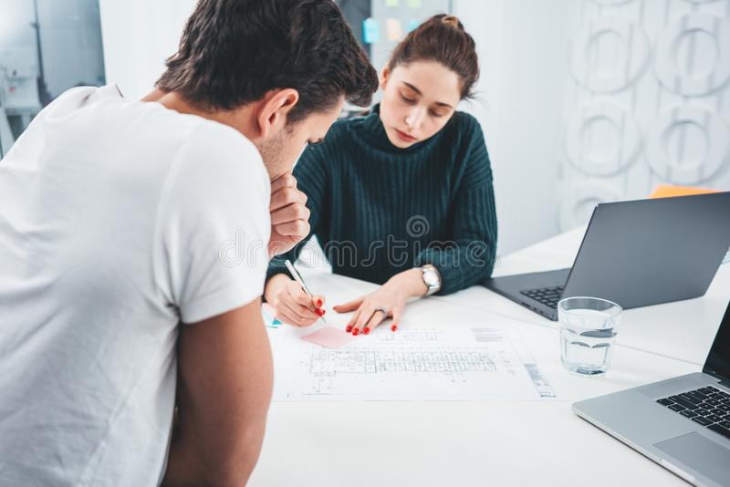 Young coworking people team sitting at table and having meeting about new great ideas stock photos