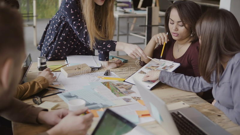 Young creative business team in modern office. Multiethnic group of people working on architectural design together. royalty free stock photos