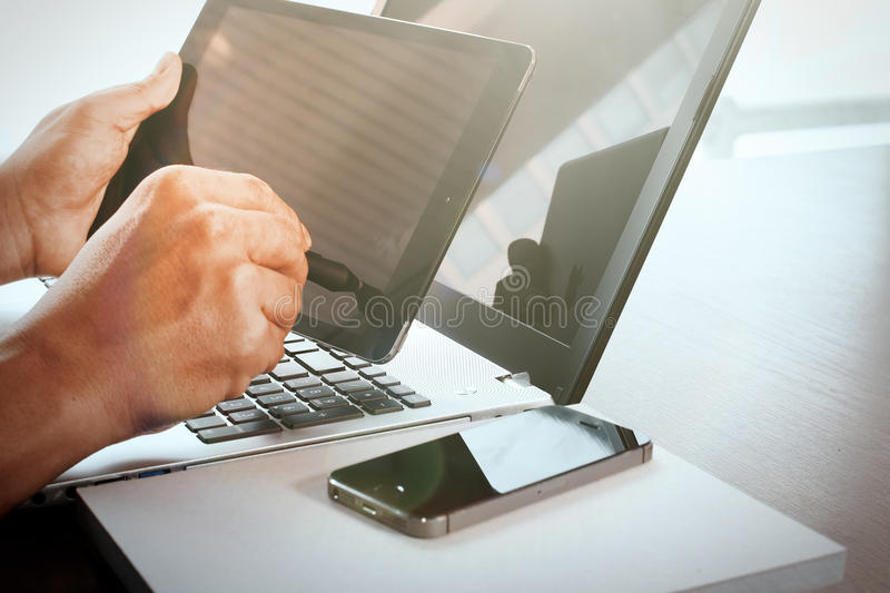 Young creative designer man working with stylus pen. And digital tablet at office and social network media diagram as concept royalty free stock image
