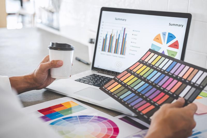 Young creative graphic designer working on project architectural drawing and color swatches, selection coloring on graphic chart. With work tools and equipment stock illustration