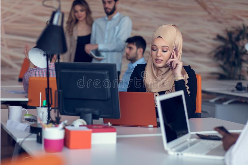 Young creative startup business people on meeting at modern office making plans and projects royalty free stock photos