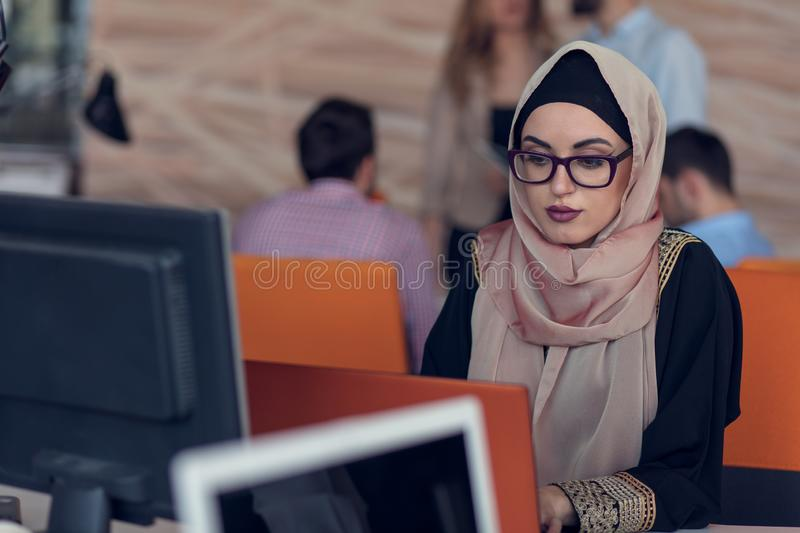Young creative startup business people on meeting at modern office making plans and projects royalty free stock photo