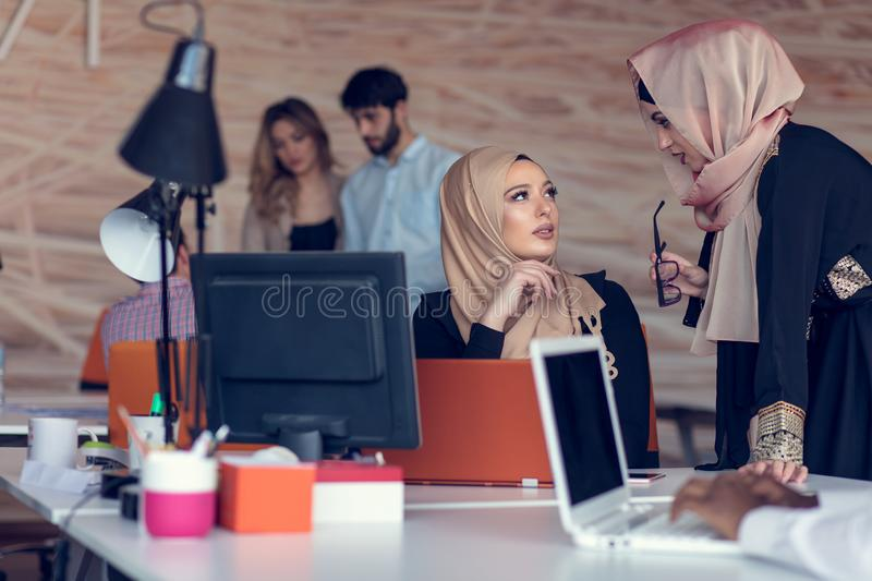 Young creative startup business people on meeting at modern office making plans and projects stock image