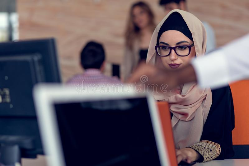Young creative startup business people on meeting at modern office making plans and projects royalty free stock images