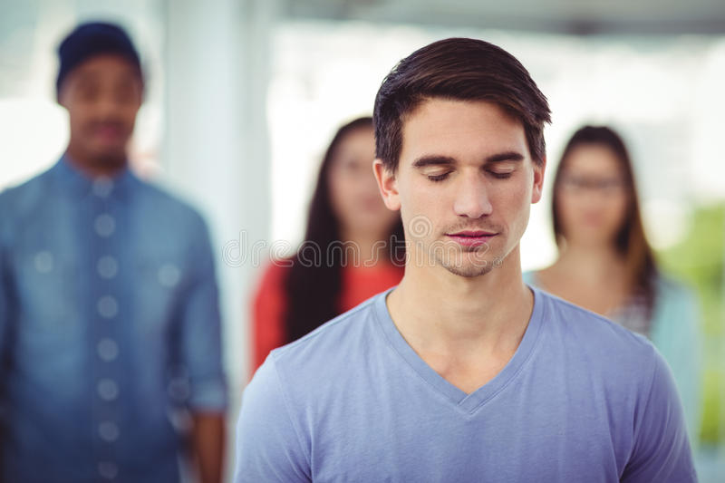 Young creative team with eyes closed royalty free stock photography
