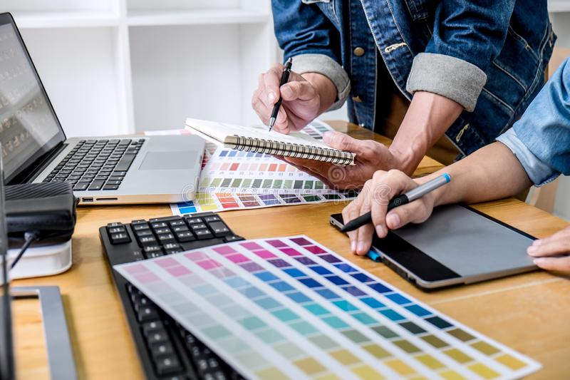 Young creative team having a meeting in creative office, Architectural drawing with work tools and accessories, Color swatch stock images