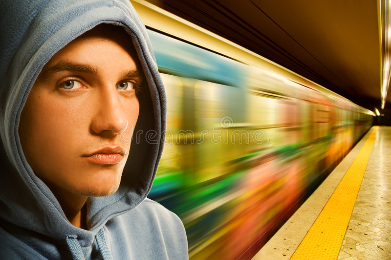 Young criminal in subway. Picture of a Young criminal in subway royalty free stock images