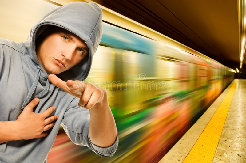 Young criminal in subway. Picture of a Young criminal in subway royalty free stock photo