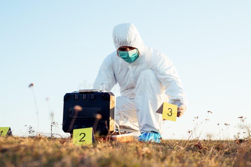 Criminologist investigates a crime scene. Young Criminologist investigates a crime scene royalty free stock image