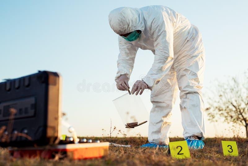 Criminologist investigates a crime scene. Young Criminologist investigates a crime scene royalty free stock photo