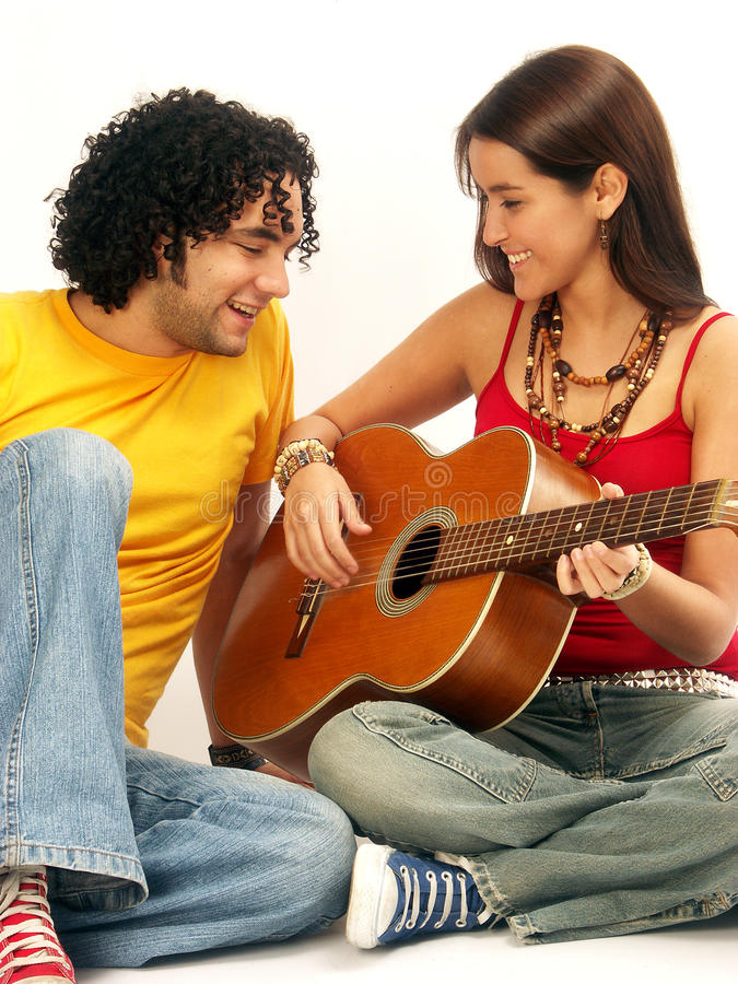Young cuople playing guitar royalty free stock image