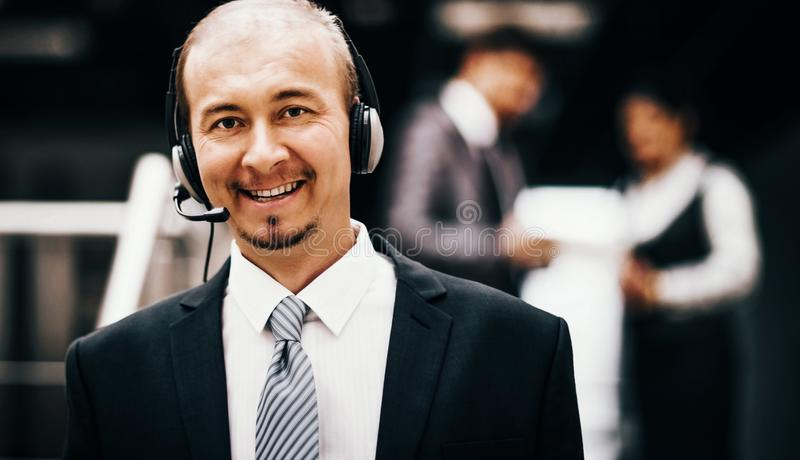 Young customer service operator talking on the headset, smiling. Young customer service operator talking on headset, smiling royalty free stock photography