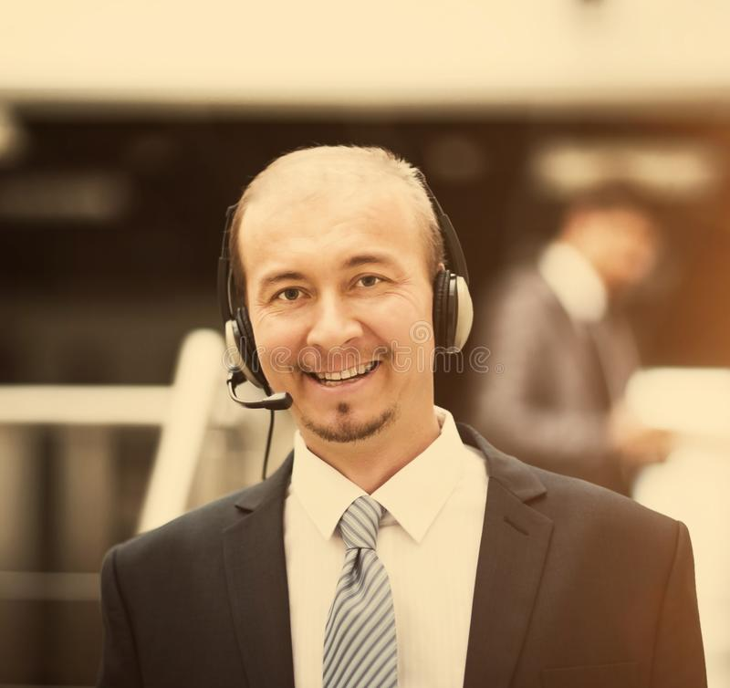 Young customer service operator talking on the headset, smiling. Young customer service operator talking on headset, smiling stock image