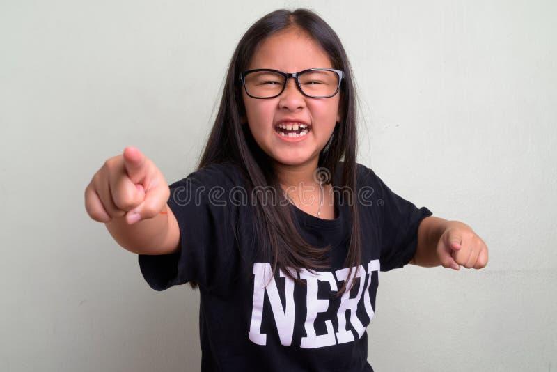 e23acd8bdcba Young cute Asian nerd girl wearing eyeglasses. Studio shot of young cute  Asian nerd girl