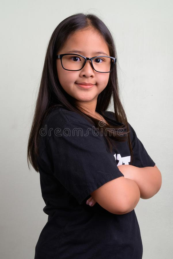 ce449fc4457a ... eyeglasses against white background · Young cute Asian nerd girl  wearing eyeglasses. Studio shot of young cute Asian nerd girl