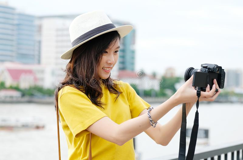 Young cute asian woman in casual style making selfie with camera in the urban city outdoors background, woman selfie,  people royalty free stock photo