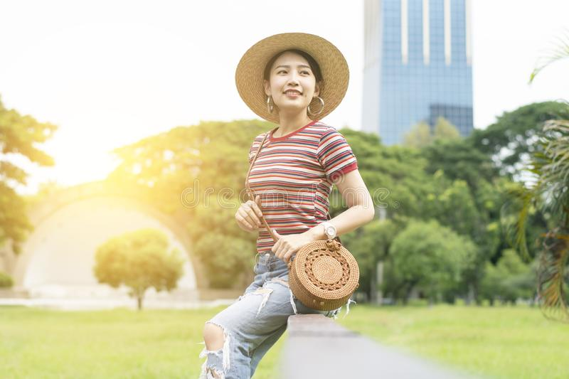 Young and cute Asian woman is enjoy lifestyle and travel into the Lumphini Park royalty free stock images