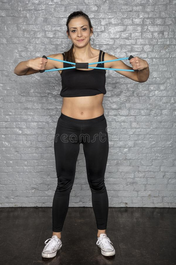 Young cute athletic woman doing exercises stock photos