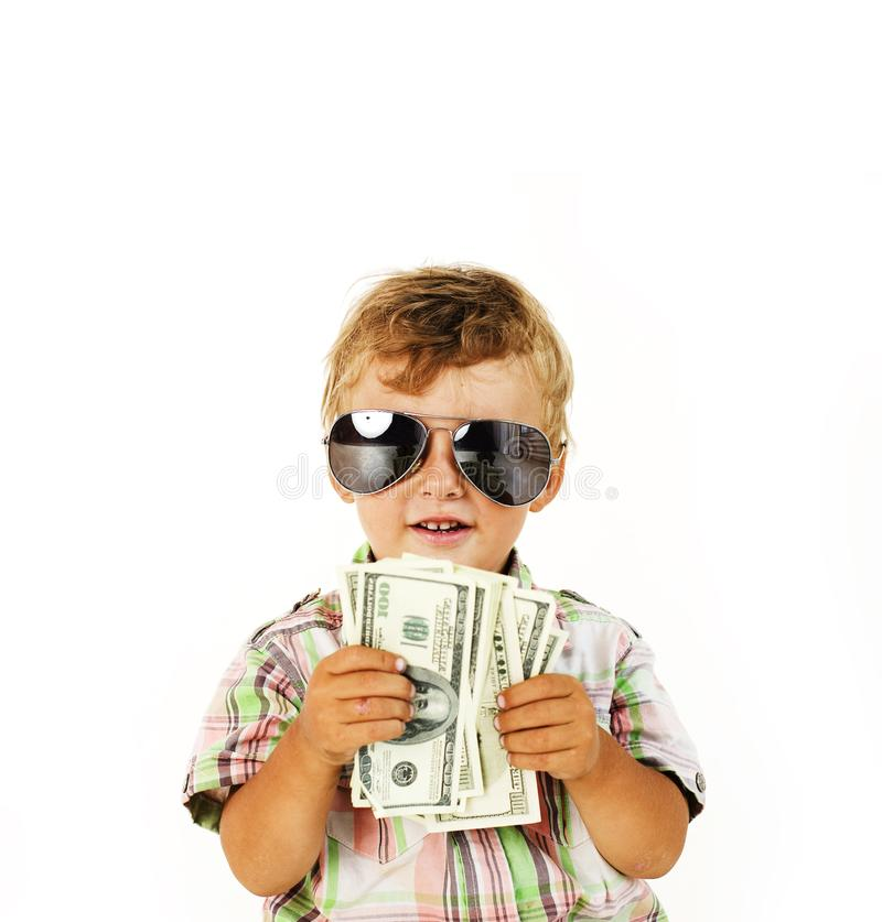 Young cute boy holding lot of cash, american dollars isolated close up stock photos